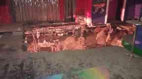 The hole opened up on the nightclub's dancefloor.