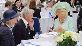 Jim Booth (centre) speaking to the Duchess of Cornwall in 2012