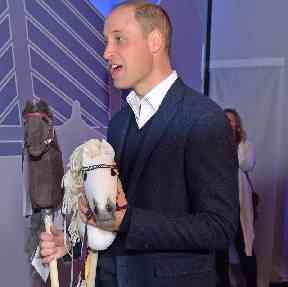 At a tech fair in Helsinki, Prince William was presented with two hobby horses, presumably for Princess Charlotte and Prince George, rather than himself and the Duchess of Cambridge.
