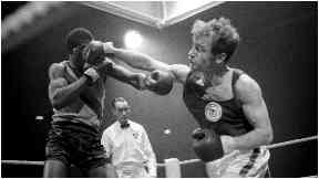Boxer Tom Imrie on his way to winning gold for Scotland in 1970.