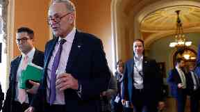 Senate Minority Leader Chuck Schumer (second left) said the bill is 'removed from the reality'.