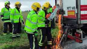 Discovery: Firefighters cut into the back of the lorry.