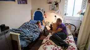 Shandor and his son Billy share a single room in temporary accommodation in Dunstable.
