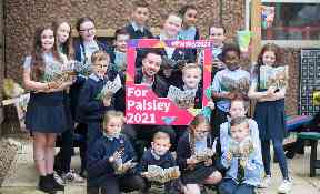 Paisley: Schoolchildren were given a specially commissioned book about the town.