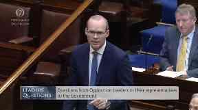 Ireland's deputy premier Simon Coveney talks in the Dail.