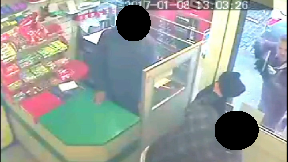 CCTV: Marshall, right, admitted possession of a weapon.