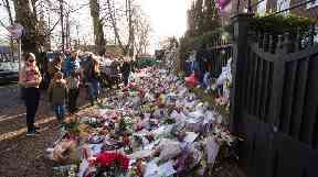 Fans laid flowers and tributes outside Michael's north London home after his death.