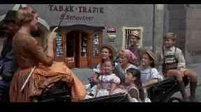 Julie Andrews and the von Trapp children in the film.