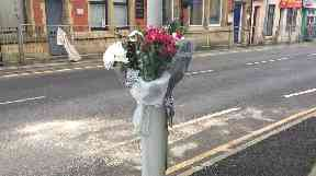 There were flowers left at the scene in tribute to the victim