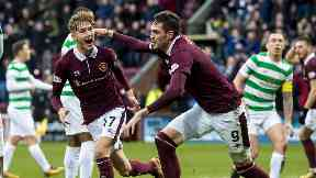 Harry Cochrane celebrates his opener in Hearts' 4-0 win over Celtic.
