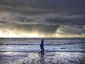 Walking under moody skies.