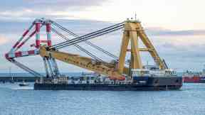 Asian Hercules III: Colossal crane will lower anchors into place.