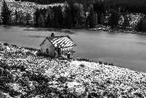 Drumore Loch with an abandoned boat house.