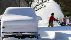 A man clears his driveway in Norwell, Massachusetts.
