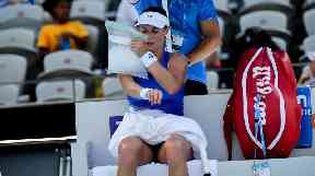 Ekaterina Makarova uses an ice bag to cool down at the Sydney International.