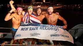 The four are believed to have set a world record in the crossing.