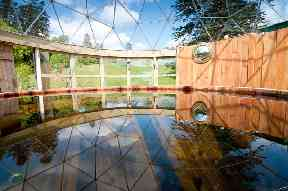 The hot tub dome with glass roof.