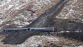Derailed: Train hit mud and debris on track.