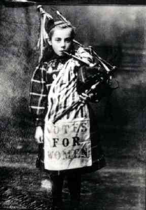 Bessie Watson, aged 9, dressed for the Womens Franchise Procession and Demonstration in October 1909. Reproduced with the permission of The People's Story, Edinburgh Museums & Galleries.