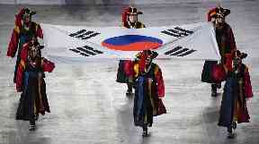 South Korean performers brought on the national flag
