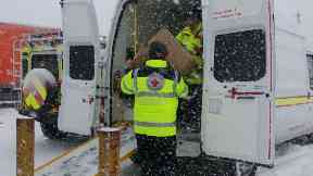 Help: Red Cross providing support at Glasgow Airport.