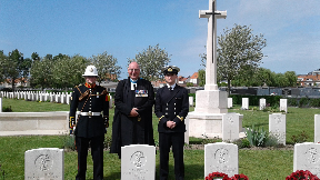Reverend (Professor) Scott J S Shackleton is joined by Navy representatives by PO McDonald's new headstone.