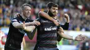 Motherwell forward Nadir Ciftci is hailed by his teammates after scoring his second.