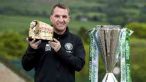 Brendan Rodgers holds aloft his Premiership Manager of the Year award.