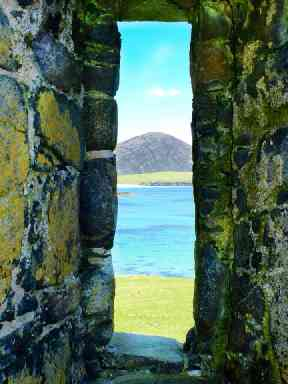 View through the window of a derelict church on Harris.