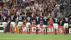 The Scotland team applaud their fans after Brazil defeat.