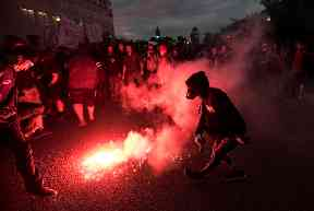 Protesters threw flares outside the summit.