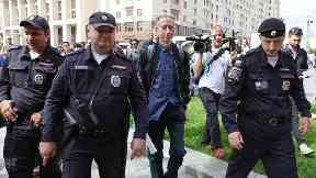 Peter Tatchell is led away by Russian police (Aaron Chown/PA)