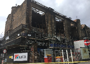Demolition: Building gutted by fire.