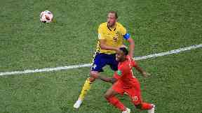 Sweden's Andreas Granqvist (left) and England's Raheem Sterling battle for the bal
