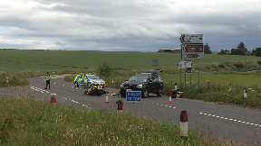 A947: Police close off road while they investigate.