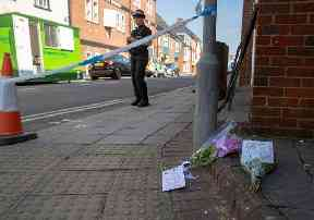 Flowers at the scene in Rollestone Street, Salisbury
