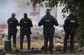 Police at the site of a Bonfire in the Bloomfield Avenue area of Belfast
