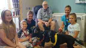 Ian enjoyed a visit from the therapets while his grandchildren Faith and Louie Mackay were visiting.