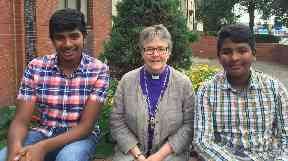 Dedicated: Somer (l) with brother Areeb and Rev Susan Brown.