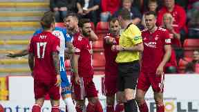Aberdeen's appeal against Mikey Devlin's red card was thrown out.