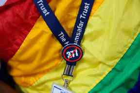 An activist wears a badge protesting against section 377 of the  law