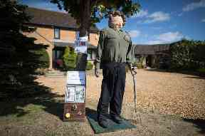 A women's land army scarecrow on display at Harpole