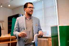 Jimmie Akesson, leader of the right-wing nationalist Sweden Democrats party, prepares to vote in Stockholm.