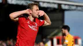 James Wilson has signed a two-year deal with Aberdeen.
