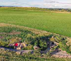 Aerial shot of the hobbit homes under the hill.