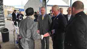 Prince Charles: Visits fish market.