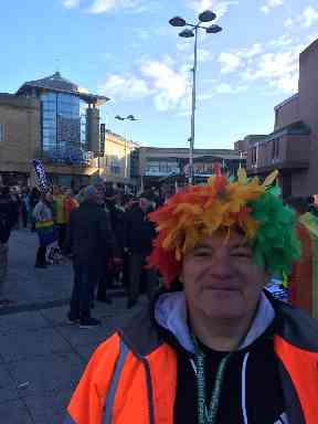 Pride: Marcher in colourful wig.