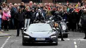 Hi-octane: Chase scene features a McLaren sports car.
