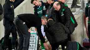 Hibs coach Neil Lennon was struck by a coin.