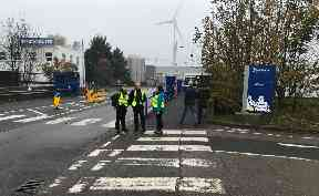 Closure shock: Workers arrive at Michelin Dundee.